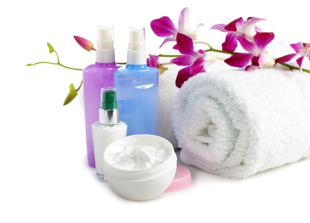 cosmetics  and towels with orchid on white background photo