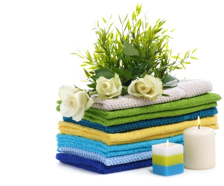 spa towels with white rosesand burn candles isolated on white background Stock Photo - 12001265