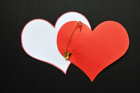 two pin  hearts on dark background Stock Photo - 12274635