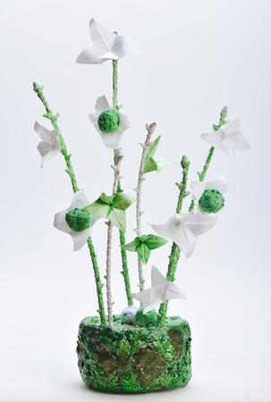 origami flowers  design in handmade green vase photo