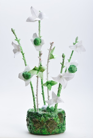 papiermache: origami flowers  design in handmade green vase