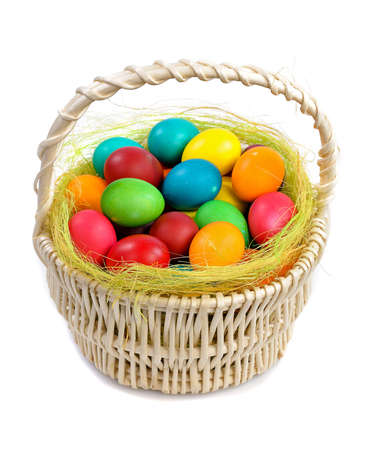 easter basket: colorful easter eggs in basket isolated on white background
