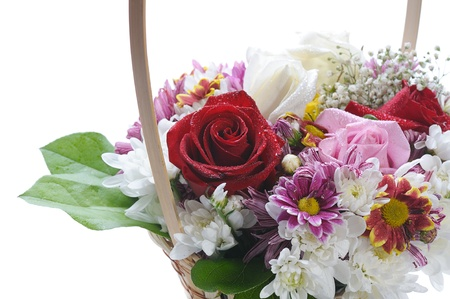 basket with flowers on white background photo