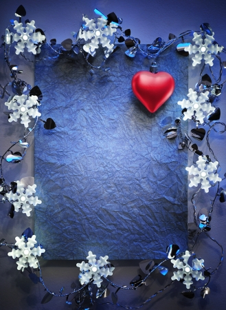 blue paper bordering with christmas decoration photo