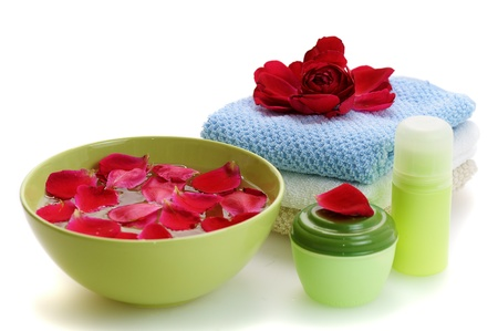 set  for spa and skin care with  green bowl filled red rose petals photo
