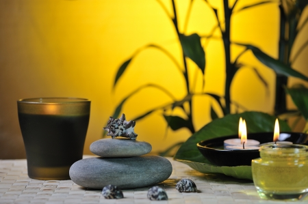 spa still life with bamboo on glowing yellow background photo