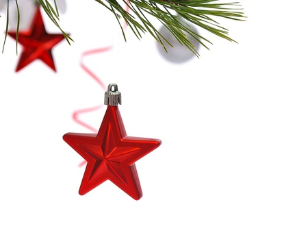 Christmas decoration -red starl in pine branch close up isolated in white photo