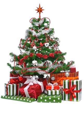 toygift: gifts under decorated Christmas tree isolated on white background Stock Photo