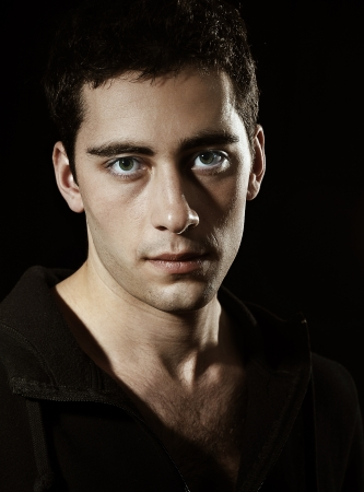 portrait of young  man  on dark background photo