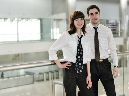 young couple smiling: young man and woman  in  office environment
