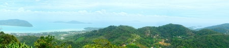 panoramic view from above high hill on  tropical seashore  and sea with islands photo