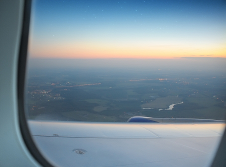 aerial view out of  airplane window on evening star sky photo