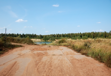 terminating: old abandoned road terminating in water of clay cast Stock Photo