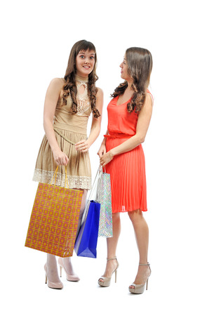 two attractive girls with shopping bags isolated on white background Stock Photo - 23132642