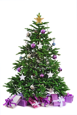 decorated Christmas tree with gifts on white background photo