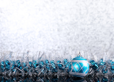 adorn: blue christmas ball with  tinsel  on glow