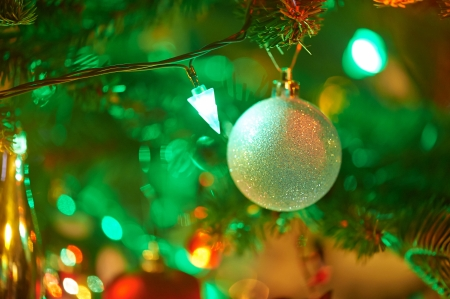 toygift: decorated Christmas fir tree with colorful lights