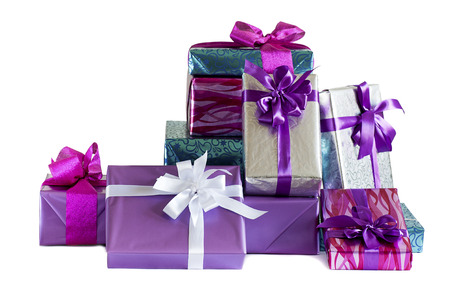 stack of festive gift boxes isolated on white background photo