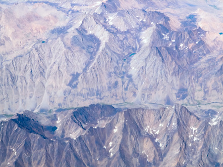 top view on the mountains of Afghanistan from a height of 10,000 meters above the Ground photo