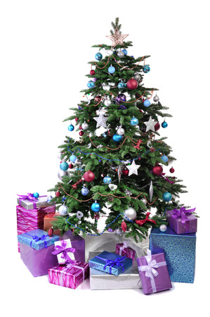 decorated Christmas tree with gifts isolated on white background Stock Photo