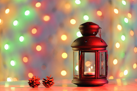 Christmas background with lantern and coloful lights photo