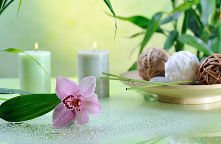 spa still life: spa still life with lilac orchid on green background Stock Photo