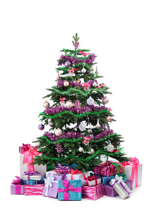 toygift: decorated Christmas tree with heap of gifts isolated on white background