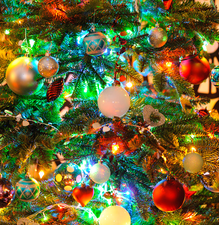 toygift: background  of inside decorated Christmas fir tree with colorful lights Stock Photo