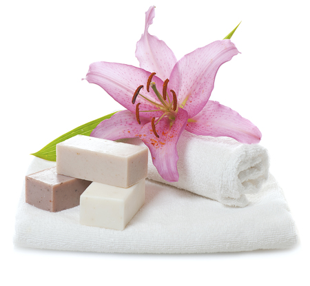 lily flowers: bars of herbal spa soap with white towels,candles and flower