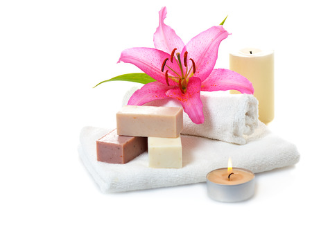 white towels: bars of herbal spa soap with white towels,candles and flower