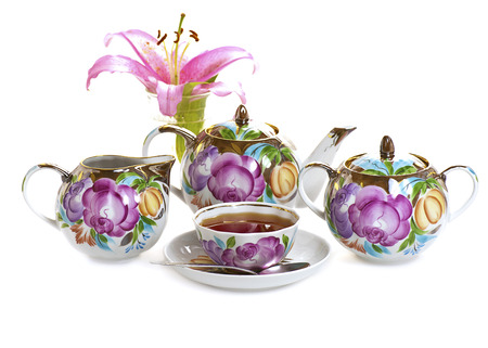gold colour: tea set isolated on white background