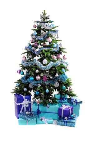 christmas isolated: blue Christmas gifts under tree isolated on white background Stock Photo