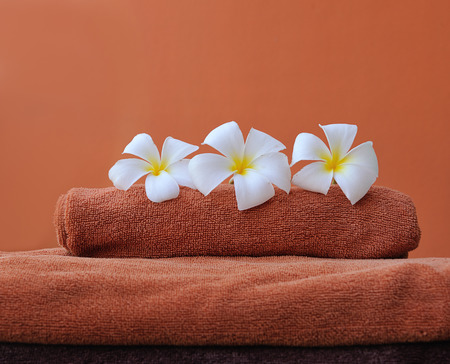 white towels: orange towels with white frangipani flowers against orange background