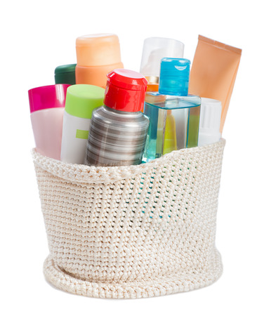 toiletries: set of toiletries in basket isolated  on white background Stock Photo