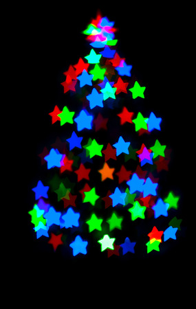 glowing star: glowing christmas tree with star bokeh on dark background