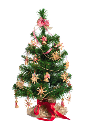 toygift: Christmas tree with straw toy decoration isolated on white background