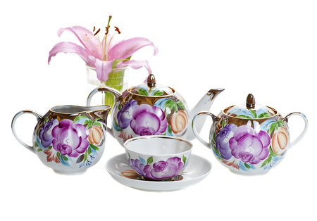 floral objects: decorated with floral pattern tea set isolated on white background Stock Photo