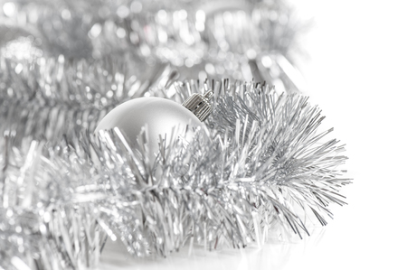 silver balls with silver tinsel on white  background