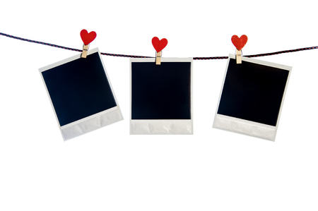 three photoframes with red heart clothepins  on string isolated on white background