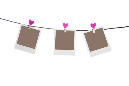 three photoframes with red heart clothepins  on string isolated on white background Stockfoto