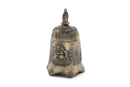 antiquities: gold hand bell on white background. Isolated on white