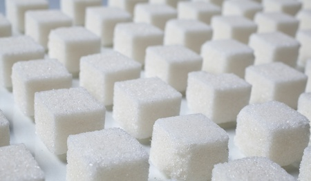 pile of sugar cubes  on whtie background photo