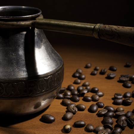 caffiene: Hot coffee in a cup against grains