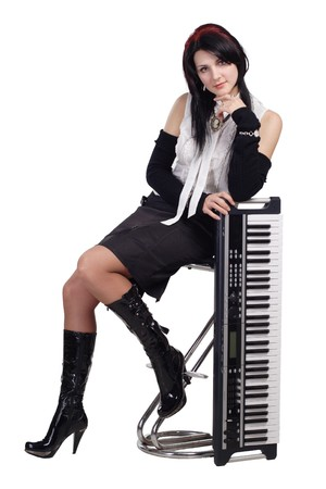 synthesizer: Beautiful girl sitting with synthesizer isolated