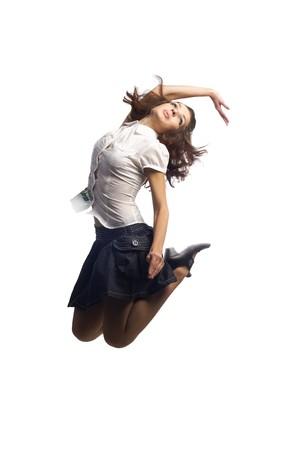 blusa: Chica en falda saltar aislado blanco  Foto de archivo