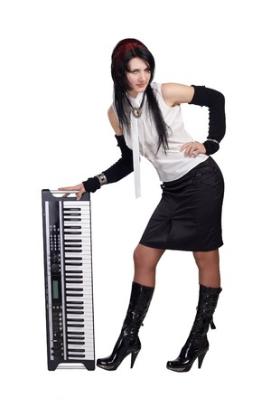 staying: Beautiful girl staying with synthesizer isolated Stock Photo