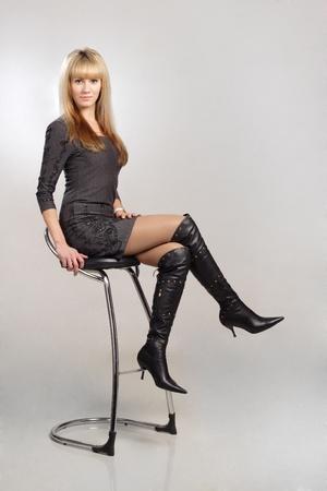 beautiful blond sexy woman sitting on chair photo