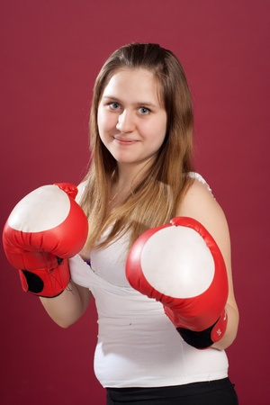 Portrait of girl in boxing gloves photo