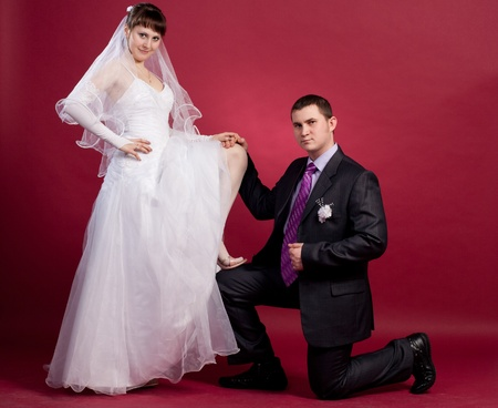 Couple newlyweds in wedding dress and suit photo