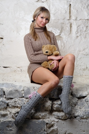 sexy girl with teddy bear sitting on wall Stock Photo - 9846875